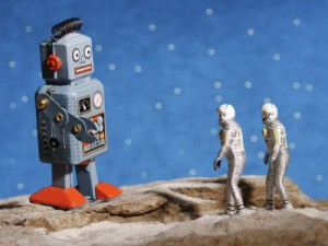 astronaut-figurines-meeting-space-robot