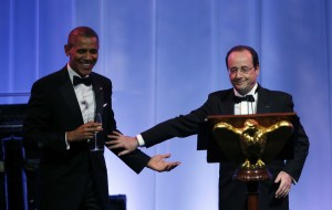 Obama and Hollande toast during the State Dinner at the White House in Washington