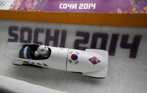 South Korea's Kim Dong-hyun and Jun Jung-lin speed down the track during the two-man bobsleigh event at the 2014 Sochi Winter Olympics