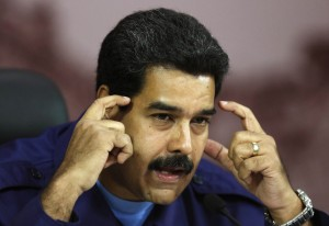 Venezuelan President Nicolas Maduro attends a press conference at Miraflores Palace in Caracas