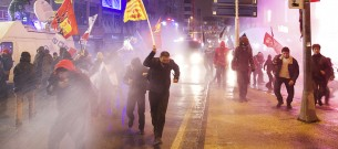 Protesters run away from water cannon and tear gas used by riot police during a demonstration against Turkey's Prime Minister Tayyip Erdogan in Istanbul