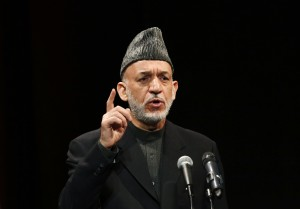 Afghan President Karzai speaks during the opening of the Bayat Media Centre in Kabul