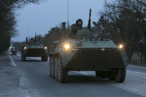 Russian military armoured personnel carriers (APC) drive on the road from Sevastopol to Simferopol