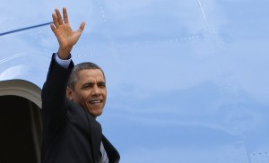 U.S. President Barack Obama waves as he leaves Rome's airport