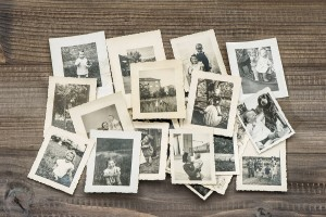 Bigstock-71816099-Old-Family-Photos-On-Wooden-Table-1