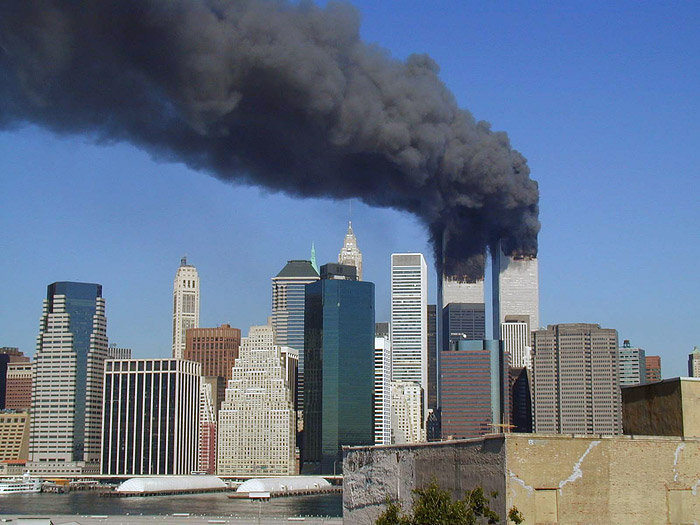 Plumes of smoke billow from the World Trade Center towers, Septe
