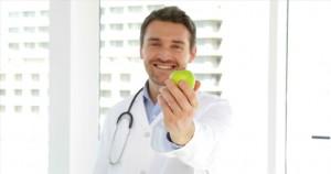 560228975-organic-food-diet-presenting-apple-fruit